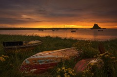 Morning Gold (Captain Nikon) Tags: lindisfarne holyisland boats dawn sunrise spectacular morninglight yachts glowing memorable northumberland northeast coastal tidal nikond7000 castle lindisfarnecastle