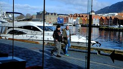 Bergen harbour (halifaxlight) Tags: street men norway reflections walking view sunny fjord colourful bergen powerboat bryggen