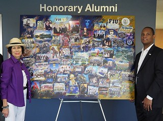 Artist Erika King presents her latest commission in honor of FIU's 50th anniversary, with Duane Wiles, alumni association executive director
