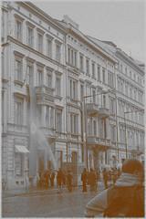 Making rain (triflintuba) Tags: travel prague czechrepublic tv series street film watering props swastika rain