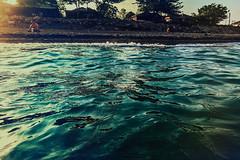 Those vintage houses (Melissa Maples) Tags: cameraphone sunset sea summer man david beach apple water turkey evening asia mediterranean sundown dusk trkiye huts antalya shacks iphone  iphone6 konyaaltbeach