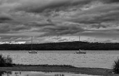 Hatches battened (Explored) (OzzRod) Tags: sky blackandwhite lake monochrome rain clouds boat pentax yacht australia lakemacquarie k3 pentaxsingleinjuly2016 hdpentaxdfa2470mmf28