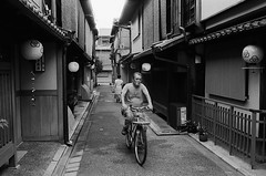 With a Cigarette (Purple Field) Tags: contax g2 rangefinder carl zeiss g planar 35mm f20 fuji neopan iso400 presto bw monochrome film analog kyoto japan street alley walking people bicycle                   canoscan8800f stphotographia
