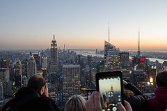 Top of the Rock sightseers (Spannarama) Tags: city sunset usa newyork skyline night buildings lights lowlight hands manhattan rockefellercenter empirestatebuilding bluehour tablet topoftherock ipad