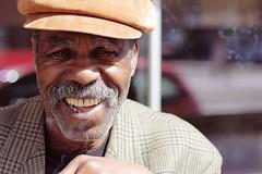 Man with a big smile (polybazze) Tags: street city urban man smile face hat happy interestingness europe dof sweden cigarette smoke interestingness1 dude cap malmö dannyglover möllan möllevången flickrhivemindgroup