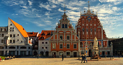 Tourists walk on the Town Hall Square in Riga (Viktor Descenko) Tags: old city blue light summer sky people white house building art tourism church beautiful architecture vintage square town hall europe european day tour view outdoor capital group landmark center tourist medieval tourists retro latvia filter blackhead historical riga blackheads