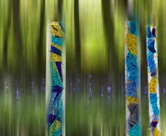 Glass sculptures in Bluebell Wood (SuQ10) Tags: abstract glass bluebells woodland motionblur sculptures