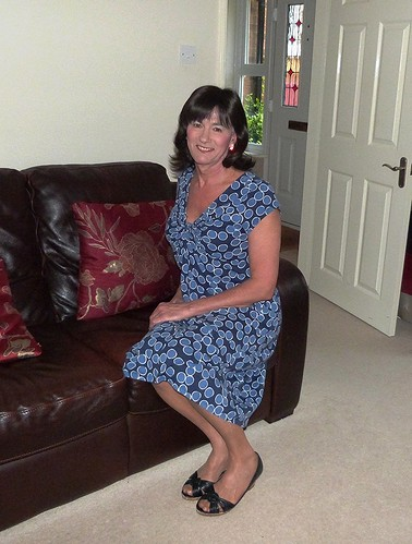 Housewife in a blue cotton summer dress