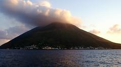 stromboli (isabellerosenberg) Tags: ocean sunset sea italy mountain island volcano boat town sicily stromboli