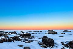 Frozen Over... (mc_icedog) Tags: winnipeg manitoba canada mb winter white rocks sky snow lake landscape luminous ice depth field morning sunrise shore serene colors early horizon illumination light nature outdoors