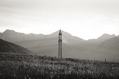 transmission tower I (blaendwaerk) Tags: white mountain black alps tower nature berg canon eos power natur meadow wiese sigma line alpen overhead schwarz transmission strommast weis 650d 1750mm