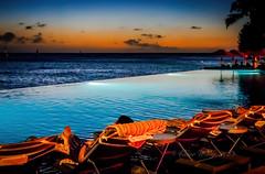 Overlooking Waikiki - Relaxing man (Victor Wong (sfe-co2)) Tags: beach water shore sea outdoor sky seascape landscape seaside deck chair waikiki honolulu hawaii usa sunset waterfront sheraton hotel relaxation man people ocean