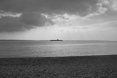 On the Horizon (Steve Harrison Photographic) Tags: uk sea blackandwhite bw seascape beach horizon aircraftcarrier usnavy warship gosport nimitzclass stokesbay usstheodoreroosevelt