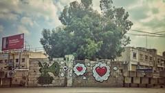 Feel the Love (Mad Mou) Tags: sky rue beyrouth liban lebanon beirut colour heart tank brickwall tree art graffiti street