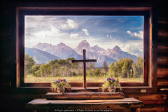 A HUNDRED DOLLAR CHURCH WITH A THREE THOUSAND DOLLAR WINDOW (Rajesh Jyothiswaran) Tags: water still mirror reflection colorful landscape parks teton tetons jackson jacksonhole grand grandteton wildlife bison grizzly bear bears sunset clouds park west western art wyoming rain thunder storms serene field outdoor skyline sky plant grass mountain historic mormon barns bunkhouse moulton barn row dusk jacksonlake catholicbay colterbay colter cathedral cathedralgroup transfiguration church log cabin window chapel