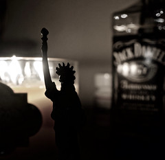 Liberated (CsGonda) Tags: liberty whiskey drink candle lady new york jack daniels shots dark light room