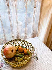 fruits (-{ ThusOriginal }-) Tags: 2009 basket china color courtyard digital drape fruit grd3 grdiii lijiang olive pomegranate ricoh table tangerine thusihaveseen window winter yunnan
