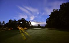 Sky Brushing (Kojaniemi) Tags: moonlit moon night golfcourse grass green forest woods coppice copse kojaniemi kimmoojaniemi shadow tree light longexposure star startrail moonlight searchlight puttinggreen