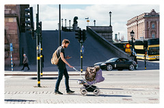 Parenting Skills (Jaf-Photo) Tags: sunlight mobile walking lights pattern phone traffic sweden stockholm stroller pavement father canvas sleepy parent leopard tired backpack noon shuffle parenting hunched onehanded lejonbacken