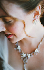 once upon a time, part five (manyfires) Tags: wedding portrait love film analog 35mm bride necklace bokeh marriage nikonf100