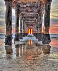 sunset under the pier (lucmena) Tags: hdr pier manhattanbeach california colorful sunset twilight outdoor beach sand waves water ocean pacificocean manmadestructure perspective dramatic scenic seascape sky clouds vertical architecture reflection losangeles ca usa