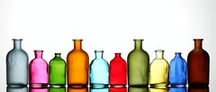 Bottles (Karen_Chappell) Tags: pink blue red stilllife orange brown white green glass yellow bottle colours bottles shapes multicoloured row line colourful