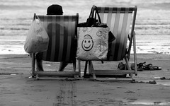 Bags Of Life (DobingDesign) Tags: seaside deckchairs resting together smiley bags shopping stripes bythesea sea beach barefeet coast blackandwhite ilfracombe devon chairs relaxing holidaymakers vacation tourists sand tracks woolacombe sandals feet outdoor britishsummer englishseaside