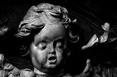 That Evil Death Stare... (ShelleyCorinne) Tags: olympusepl1 olympus olympuspen micro43 bw blackandwhite monochrome cherub creepy disturbing unnerving petworthhouse chapel dark shadows child baby
