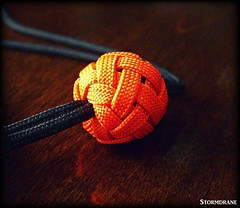 paracord wrist lanyard with gaucho knot (Stormdrane) Tags: paracord 550cord gutted ungutted gaucho double knife lanyard knot boatswain whistle diamond edc everydaycarry rigging marlinspike lock orange black attachment hiking camping backpacking fishing boating sailing scouting bushcraft geocache tying tighten retention utility decorative useful make hobby craft camillus madeinusa tutorial links