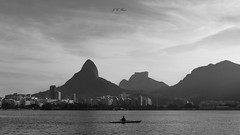The rower , Lagoa Rodrigo de Freitas | Rio de Janeiro (Jos Eduardo Nucci) Tags: olympicgames lagoarodrigodefreitas riodejaneiro people athlete brazilian rower monochrome blackandwhite atmosphere landscape nikon 28300mm jos photography getty happy beautiful love peace famous cities travel magical sunset light serenity calm dream sweet marvelouscity rio450anos ipanema leblon beach tropical beauties southamerica pretoebranco nature nucci images picture pier dramatic sky cityscape lagoon instagram rio2016 monocromtico clouds stunning vibe world environment copacabana tour fantastic harmony br shot rj flickr explore sun