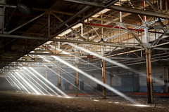 A Lack of Fire & A Lot of Smoke ([jonrev]) Tags: light urban sun abandoned effects boat haze marine factory floor empty smoke exploring line vacant boating motor streams rays stripped beams assembly urbex manufacturing