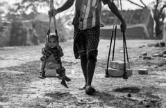 fatherhood (AanupamM) Tags: travel people blackandwhite man canon 50mm child father son worker fatherhood brickfield