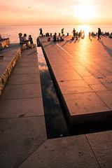 Summer evening reflection (Maria Eklind) Tags: sunlight sunset nature reflection spegling city people vstrahamnen trdcket moln clouds himmel sun summer resund siluett malm boardwalk water vatten sundspromenaden solnedgng goodnightsun silhouette europe sky sweden skneln sverige se