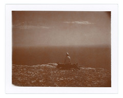 Alone again (Andrey Timofeev) Tags: 20may2015 mamiya universal mamiyasekor 100mm f35 polaroid 100 sepia film iso 1500 impossible project paul giambarba edition expiredfilm bestbefore102009 rangefinder  land camera back instant colour pack crimea  mountains  landscape  view  nature  analogue analog  shades  mood  atmosphere  sky  sea  horizon   vastness  girl   stones rocks  clouds  snag    cliff  original    alone