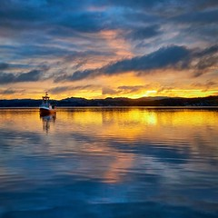 Ryksund, Norway (Vest der ute) Tags: g7x norway rogaland ryksund sunrise reflections clouds boat seascape fav25 fav200