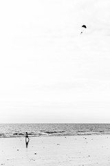 Flying Solo (Hugh Rawson) Tags: france beach normandy monochrome street sky stgermainsuray streetphotography streetphotograph bw mono