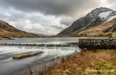 Tryfan Mountain (Adrian Evans Photography) Tags: nantffrancon snowdonia landscape lakeogwen idwal landmark ogwenlake weir outdoor lake longexposure valley clouds ogwenvalley wales ogwen photograph uk water pass adrianevans northwales tryfan sky snowdonianationalpark wall winter snow mountain nikon d800 20mm ndfilter nd10