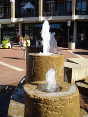 Lake Anne Plaza, Reston (dckellyphoto) Tags: reston lakeanne lakeanneplaza virginia restonvirginia restonva plaza concrete modern brick water jets fountain bubbling spray women child boy woman female people fairfaxcounty summer