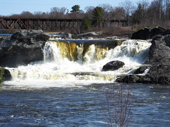 Androscoggin River Great Falls (RonG58) Tags: pictures new trip travel trestle light usa color nature water river landscape geotagged photography us photo waterfall spring day image photos live greatfalls maine picture auburn images photograph digitalcamera exploration riverwalk lewiston mizu photooftheday picoftheday leau traintrestle fugifilm androscogginriver elagua daswasser rong58 finepixhs50exr lewistonauburnriverwalk