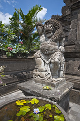 Watching the lotus... (Bahanick --(Next upload: Luzern)) Tags: camera original light bali art colors up look stone composition contrast dark indonesia religious temple for reflex seaside ancient asia raw foto with arte bright image good picture shapes statues buddhism saturation su bud visual hinduism emotions per curiosity colori sculptures con carvings luce forme barong denpasar sensation riflesso composizione scuro sensazioni immagine emozioni chiaro tonality visivo