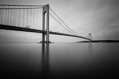 Sleepless in New York (Amar Raavi) Tags: nyc newyorkcity longexposure bridge blackandwhite bw usa ny newyork water monochrome brooklyn sunrise dawn unitedstates statenisland longest suspensionbridge verrazanobridge verrazanonarrowsbridge thenarrows fortwadsworth giovannidaverrazzano