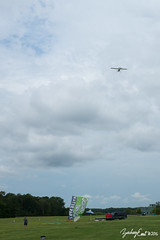 20160716-110548-5D3_4489 (zjernst) Tags: sign museum advertising airplane climb virginia flying aircraft aviation military ad banner aerial propeller takeoff advertise 2016