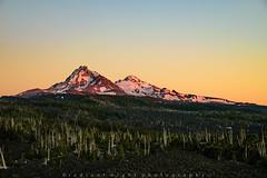 Sister's Glow (Radiant Night) Tags: alpenglow cascades lava threesisters sunset trees mckenziepass northsister sunlight sky beauty radiantnightphotography sisters middlesister carlmiller oregon unitedstates us
