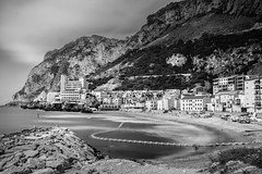 Catalan Bay (gibwheels) Tags: beach catalan bay gibraltar rocks sea shore long exposure nikon d500 lee 10 stops hotel village clouds british black white monochrome bw