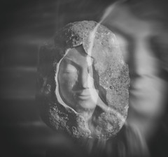 The Ghost of Mary (henriksundholm.com) Tags: doubleexposure bricks portrait marble stone rock shadows light ghost faint blur face nose mouth lips 50mm cloak dof depthoffield christian religious chuch mariakyrkan sigtuna sverige sweden bw blackandwhite monochrome