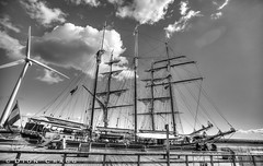 Oosterschelde (Dion Cragg) Tags: oosterschelde boat blyth tallship sailingship sailboat ship dutch netherlands moored masts bw blackwhite blackandwhite hdr windturbine windpower