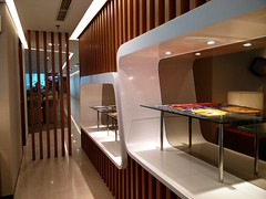 Magazine racks (A. Wee) Tags: jakarta  indonesia  airport  cgk soekarnohatta terminal3 garudaindonesia lounge