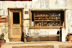 Horse Shoes and Glass Treasures (nedlugr) Tags: california ca door window bench desert bottles ghosttown horseshoes ruraldecay corrugated mojavedesert glassware randsburg ruralwest