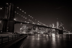 Brooklyn Bridge and Lower Manhattan (Piotr_PopUp) Tags: nyc newyorkcity longexposure sea blackandwhite bw reflection water monochrome brooklyn night river dark blackwhite nightlights nightshot noflash brooklynbridge slowshutter hudson nocturne lowermanhattan nightphotos