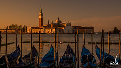 Golden Light in Venice (anoopbrar) Tags: venice venzia italy canals water reflections gandola evening twilight bluehour travel landscape architecture buildings sunset sunrise outdoor longexposure picturesque city explore landscapephotography night dusk travelphotography beautiful europe art artistic goldenhour goldenlight gondola reflection